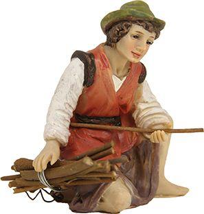 Hirte kniend mit Holzbündel