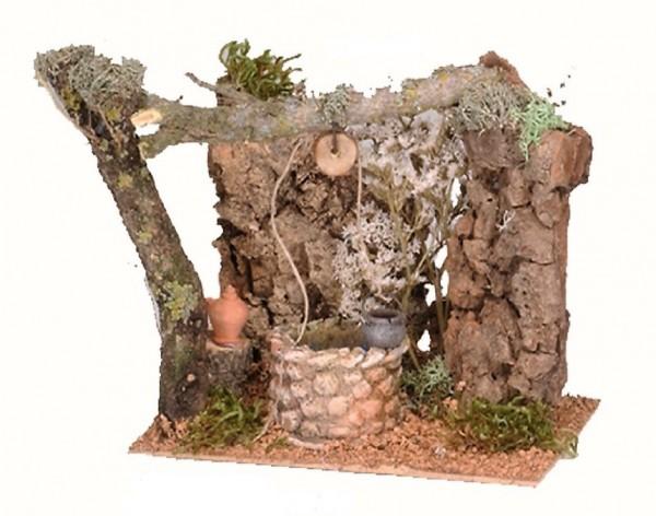 Brunnen mit Baum und Fels