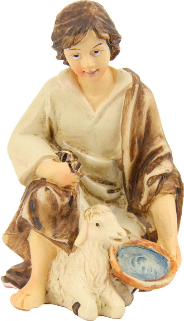 Hirtenjunge kniend mit Schaf